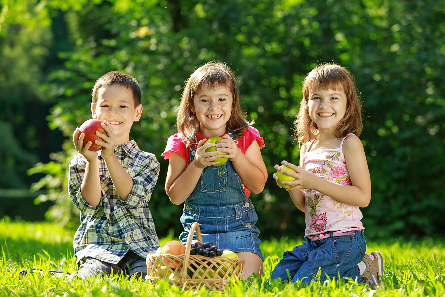 Kids outside with apples
