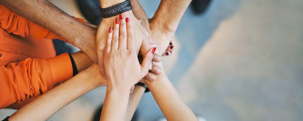 Team work hands in support